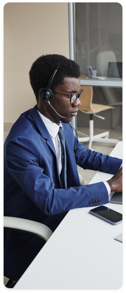 Man With Headsets On Cloud PBX Call