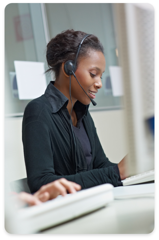Woman With Headsets On Hybrid PBX Call